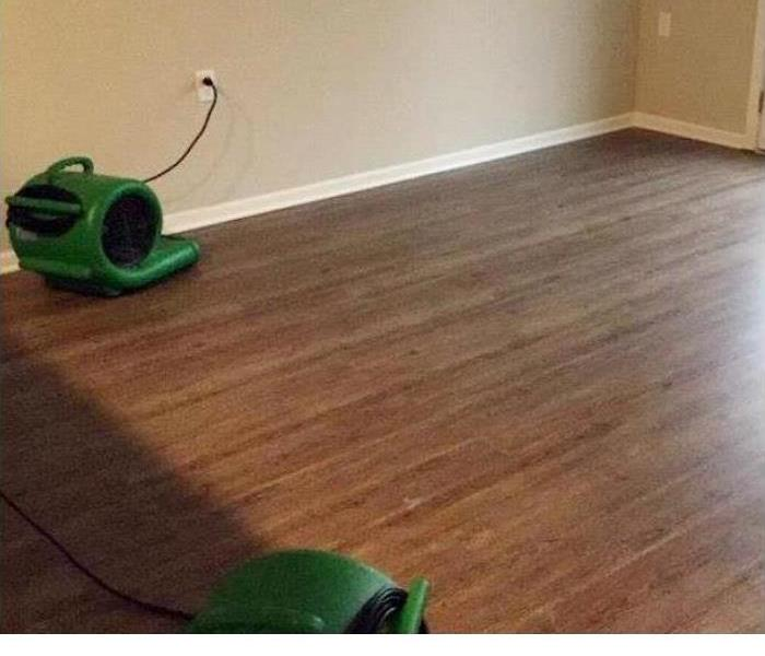 dry hardwood flooring with two green air movers placed